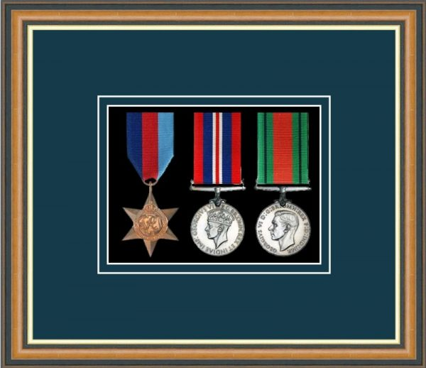 Walnut picture frame for three military medals with nightshade mount