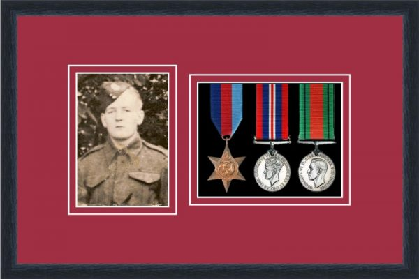 Black picture frame for three military medals/photo with beaujolais mount