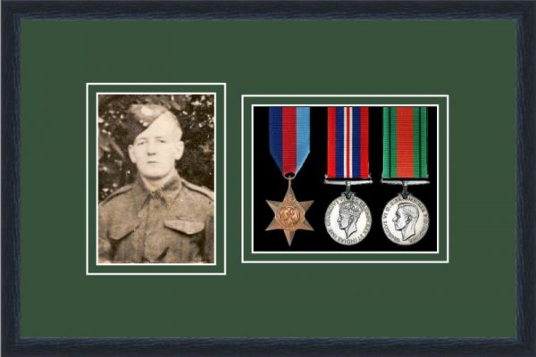 Black picture frame for three military medals/photo with forest green mount