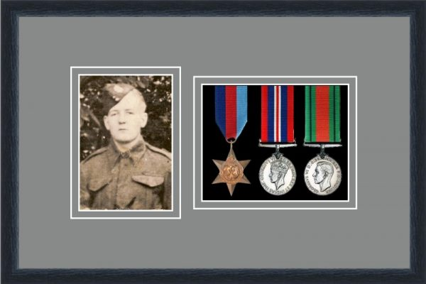 Black picture frame for three military medals/photo with grey mount