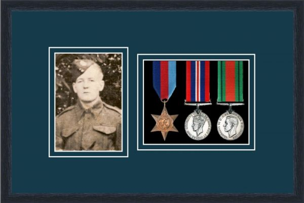 Black picture frame for three military medals/photo with nightshade mount