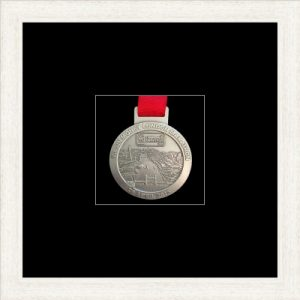 White woodgrain picture frame for one marathon medal with black mount