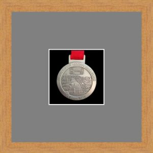 Light woodgrain picture frame for one marathon medal with grey mount