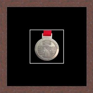 Dark woodgrain picture frame for one marathon medal with black mount