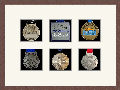 Dark woodgrain picture frame for six marathon medals with antique white mount