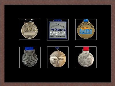 Dark woodgrain picture frame for six marathon medals with black mount