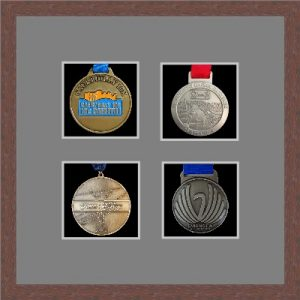 Dark woodgrain picture frame for four marathon medals with grey mount