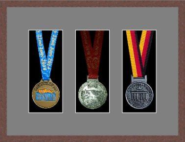 Dark woodgrain picture frame for three marathon medals with grey mount