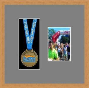 Light woodgrain picture frame for one marathon medal/photo with grey mount