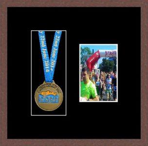 Dark woodgrain picture frame for one marathon medal/photo with black mount
